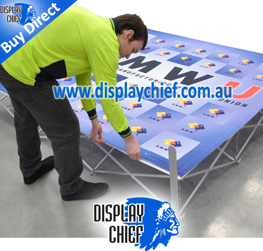 Man attaching the AMWU banner sign