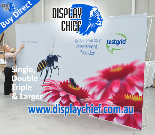 Lady inspecting the freestanding pop up display wall sign which is two frames and a single print graphic sign